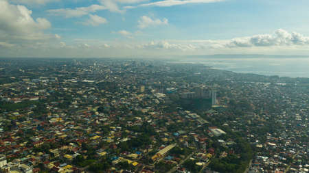 Davao city with modern buildings, business centers on the island of Mindanao view from above. Davao del Sur, Philippines.