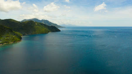 Aerial drone of the coast of Leyte island with hills and mountains covered with green forest and jungle. Philippines.