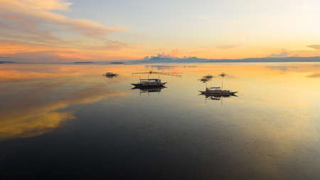 Colorful sunset over the Bay with Islands. Philippines. Sunset in the tropics.