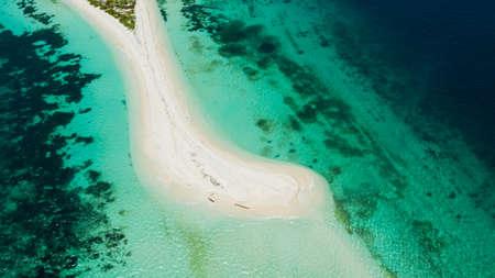 Tropical island with sand beach, top view. Little Santa Cruz Island near Zamboanga city. Mindanao, Philippines.
