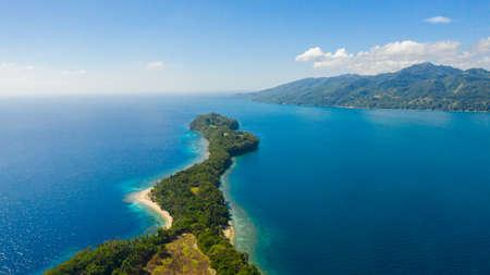 Aerial view of sandy beach on a tropical Big Liguid Island with palm trees. Big Cruz Island, Philippines, Samal.