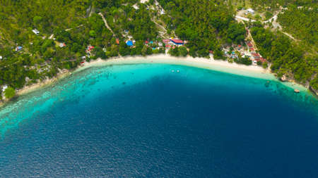 Aerial view of sandy beach on a tropical island with palm trees. Canibad beach, Philippines,Samal island.