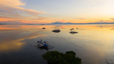 Tropical sunset over the sea and Islands in the Philippines, view from above. Sunset in the tropics. Standard-Bild