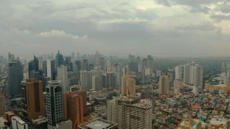 Skyscrapers and business centers in a big city Manila top view. Modern metropolis in Asia, top view.