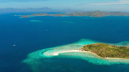 aerial seascape tropical island with sand bar, turquoise water and coral reef. Ditaytayan, Palawan, Philippines. tourist boats on tropical beach. Travel tropical concept. Palawan, Philippines
