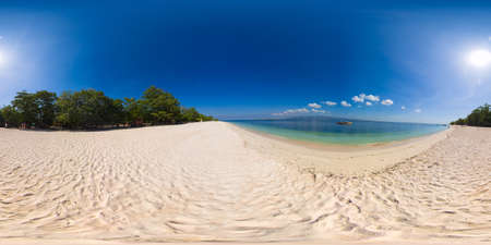 Island with a sandy beach and azure water surrounded by a coral reef and an atoll. Great Santa Cruz island. Zamboanga, Mindanao, Philippines.