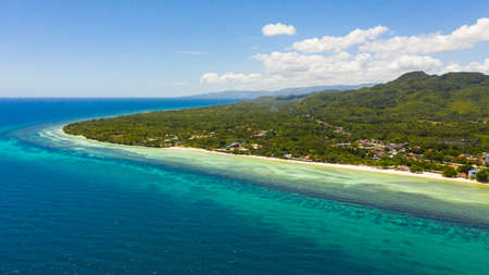 Beautiful sandy beach and turquoise water in Anda resort, Philippines.