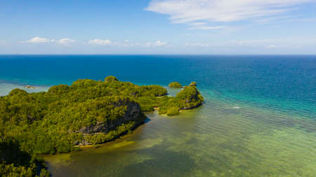 Aerial view of the mountains covered with jungle, blue sea and sky with clouds. Bohol,Philippines. Stok Fotoğraf