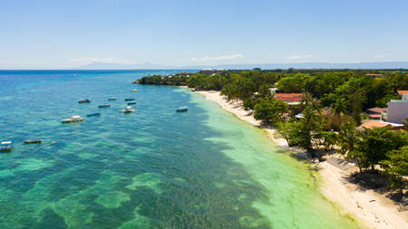 Beautiful tropical beach and turquoise water view from above. Alona beach, Panglao, Philippines. Summer and travel vacation concept. Stok Fotoğraf