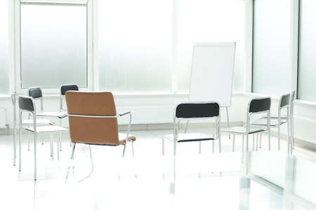 Flipchart chairs in a bright office space. Office training concept