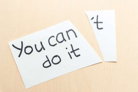 Concept of self belief, motivation an positive attitude. You can do it ,wrote on white torn paper