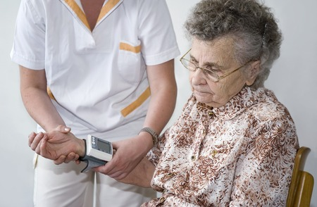 heartrate: An elderly women being examined by a doctor