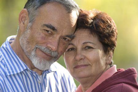 Happy elderly couple embracing outdoors Stock Photo - 1848688