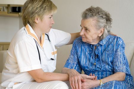 examined: An elderly women being examined by a doctor