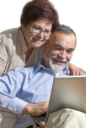 Senior couple on laptop. Concept may be is shopping in internet. photo