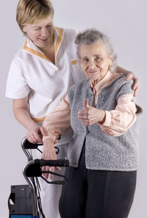 outreach: Health care worker helping elderly woman Stock Photo