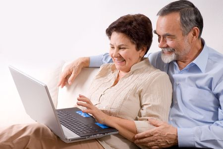 Senior couple on laptop. Concept may be is shopping in internet Stock Photo - 2407115