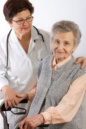 Health care worker and elderly woman needs help photo