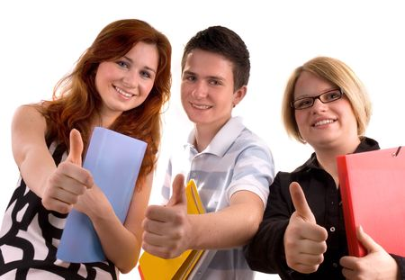 three young teenagers giving the thumbs-up sign. photo