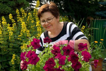 senior lady in the garden photo