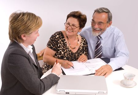 Mature couple talking to financial planner Stock Photo - 3263250