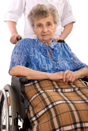 female senior adults: Health care worker and elderly woman in wheelchair needs help