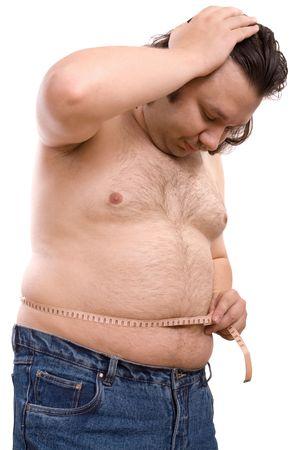 gula: hombre la celebraci�n de una cinta de medici�n Foto de archivo