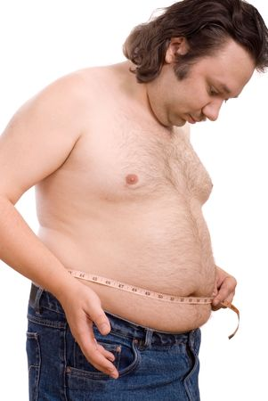 overeat: man holding a measurement tape