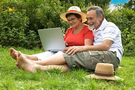 senior couple in garden at leisure with laptop computer Stock Photo - 3421249