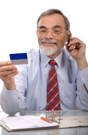 masculin: Businessman making a credit card purchase by phone