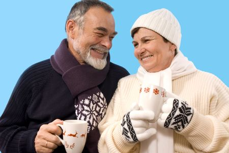 portrait of happy elderly couple drinking hot tea photo
