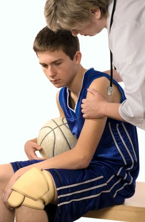 doctor giving first aid the hurt sportsman photo