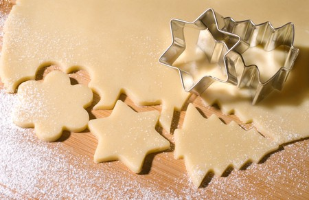 Dough and christmas cookie cutter forms