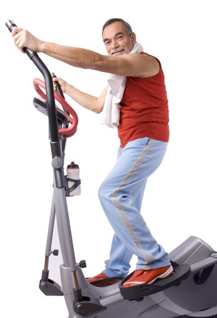 crosstrainer: Senior man working out on a  exercise machine Stock Photo