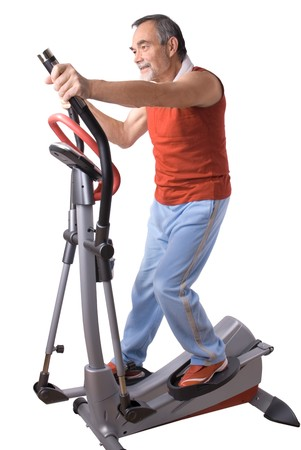 cardiovascular exercising: Senior man working out on a  exercise machine Stock Photo