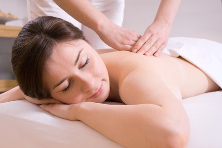 girl getting a back massage in the spa salon Stock Photo - 4074086