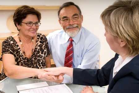 greet: business partners shaking hands  making a agreement