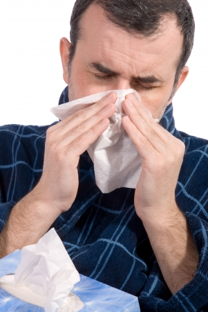 sniffles: sick man blowing his nose