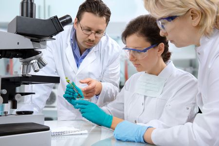 group of scientists working at the laboratory Stock Photo - 4963399