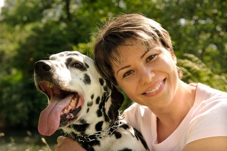 woman  with a Dalmatian outdoors Stock Photo - 5028002