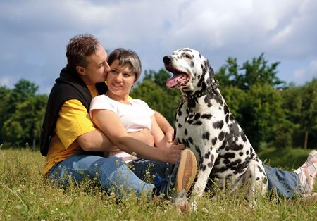loving couple with a Dalmatian outdoors Stock Photo - 5028004