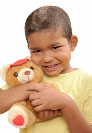toy bear: multi-ethnic boy with a teddy bear