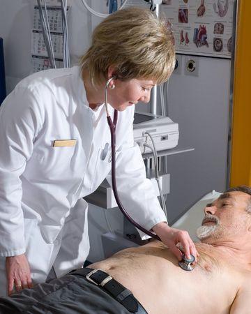 medical attendance: doctor examining an  elderly patient