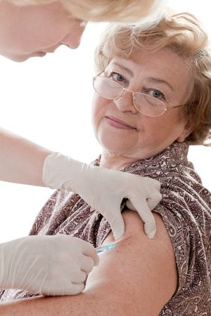 swine flu vaccination: female senior getting a swine flu injection  Stock Photo