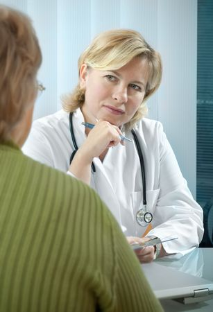 doctor explaining diagnosis to his female patient Stock Photo - 5661090
