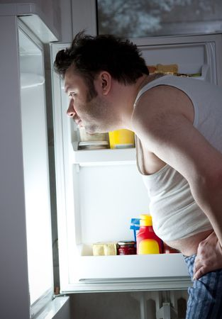 Fat man looking in fridge  Stock Photo - 5780330