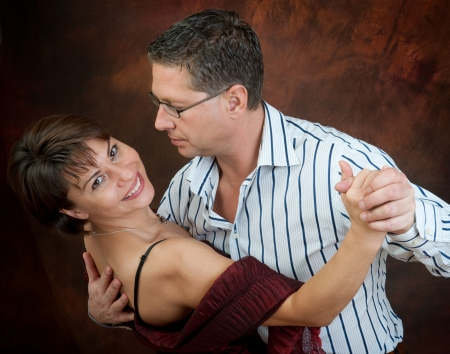 Attractive couple dancing the night away    photo