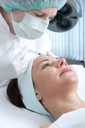 Beautiful woman receiving a botox injection