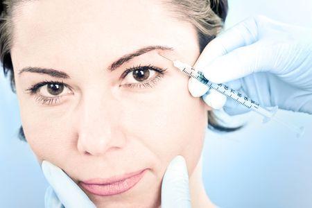 Beautiful woman receiving a botox injection photo