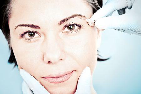Beautiful woman receiving a botox injection Stock Photo - 5890338